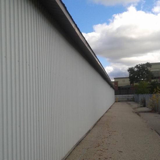Nicole Shaw paints exterior corrugated metal