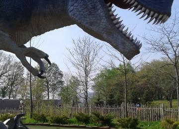 Nicole Shaw paints a three times larger than life-size T-Rex dinosaur in a mini putt in Niagara Falls Ontario Canada